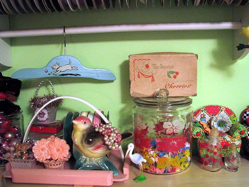Studio shelf with jar and cherry box
